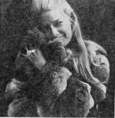Picture of young woman with a fur coat